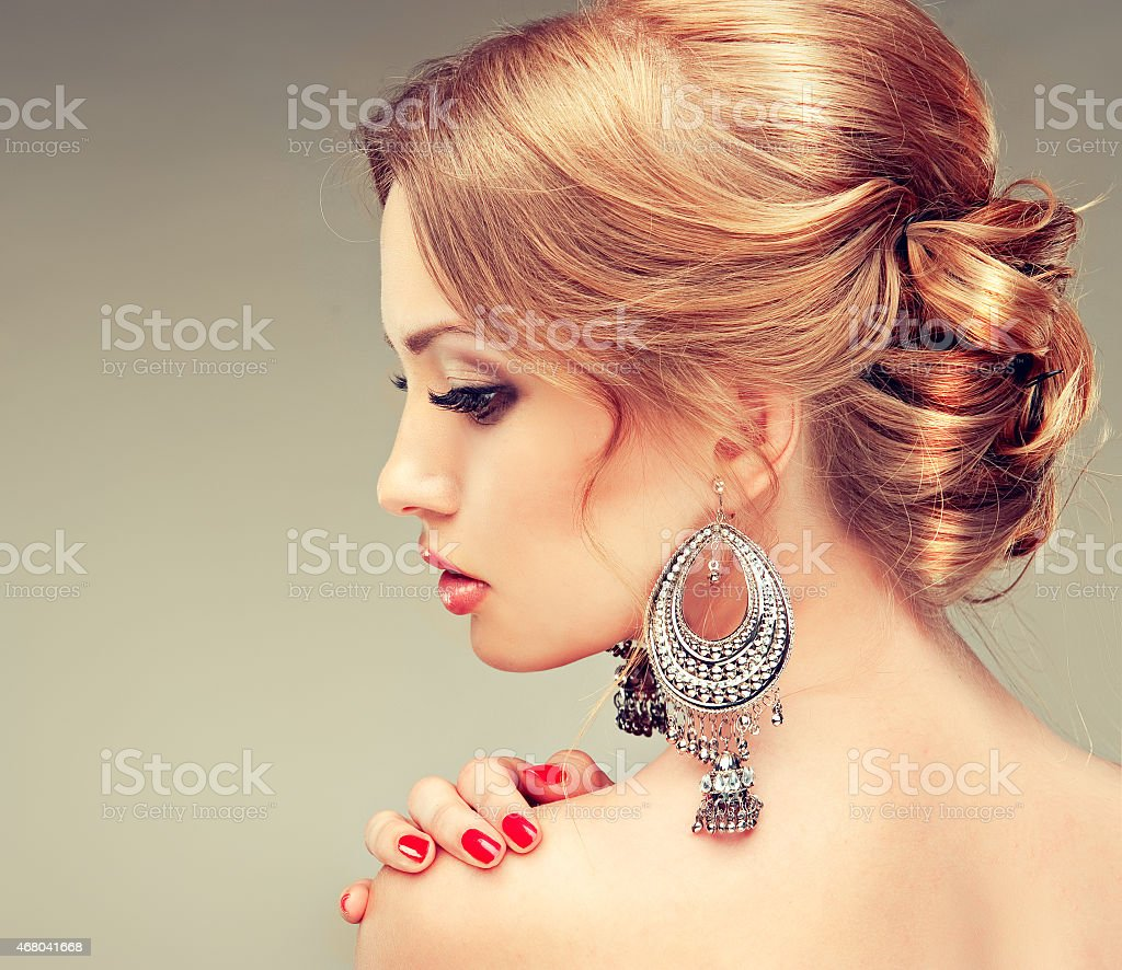 Profile of beautiful woman with red manicure stock photo