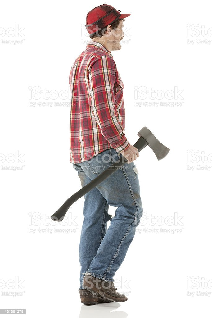 Profile of lumberjack carrying an axe royalty-free stock photo