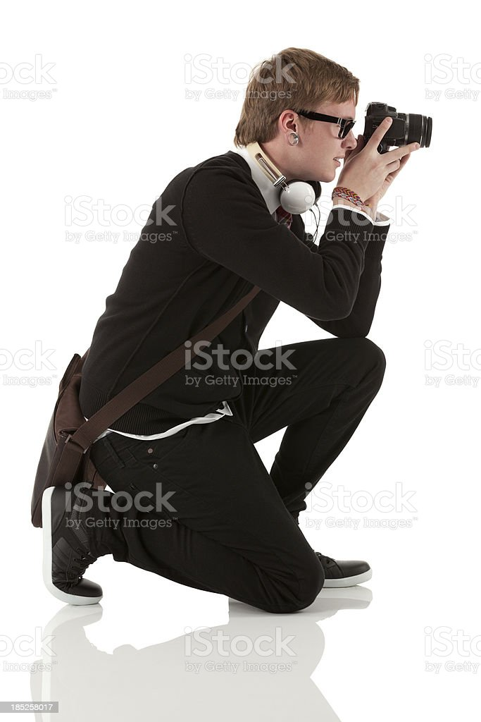 Profile of man photographing with a camera stock photo