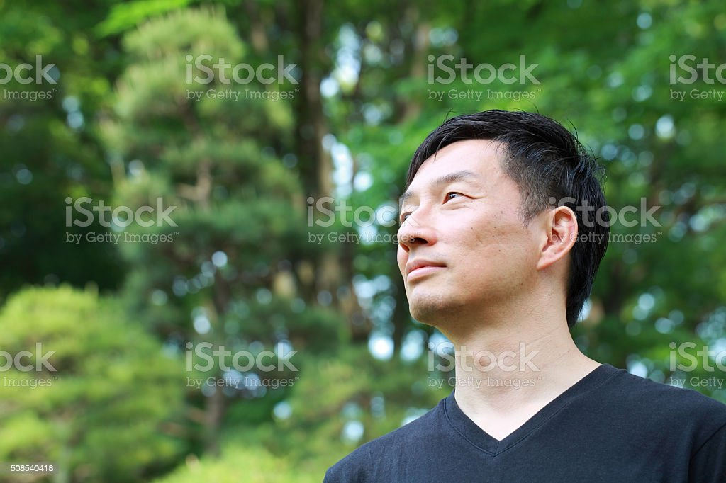 profile of middle aged Asian man stock photo
