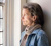Profile of middle aged woman at window