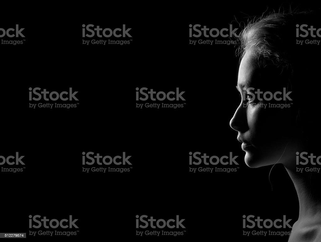 profile of sad woman stock photo
