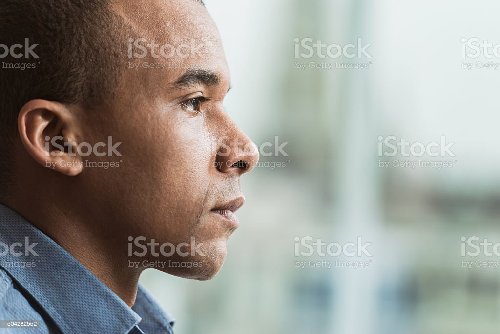 Profile of serious African American man. stock photo