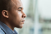 Profile of serious African American man.
