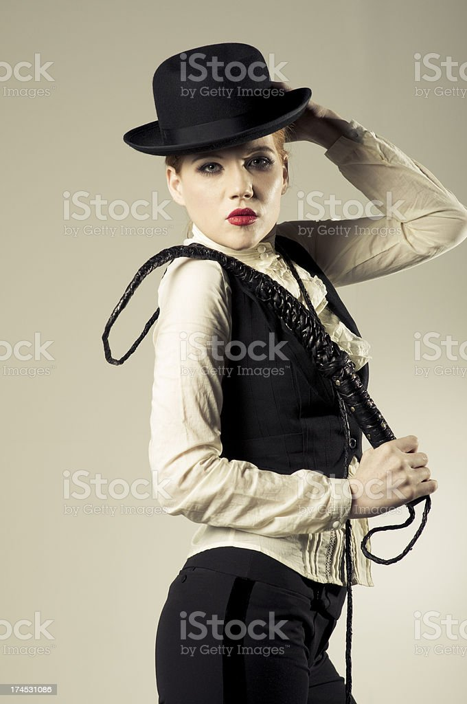 profile of sexy woman with a whip stock photo