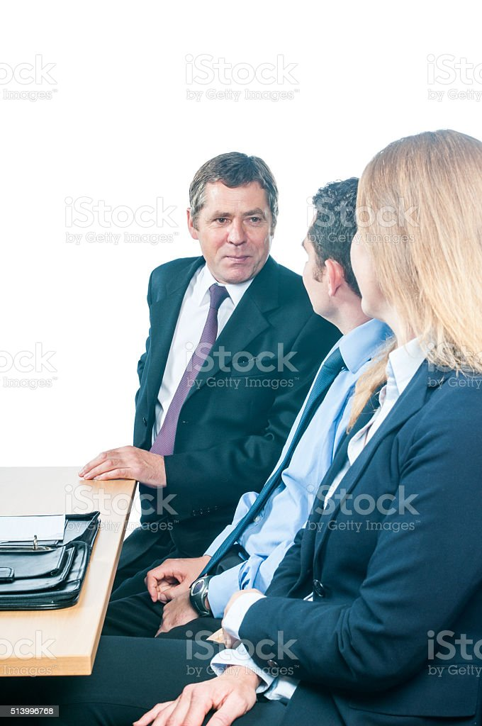 Profile Of Team In A Business Meeting stock photo