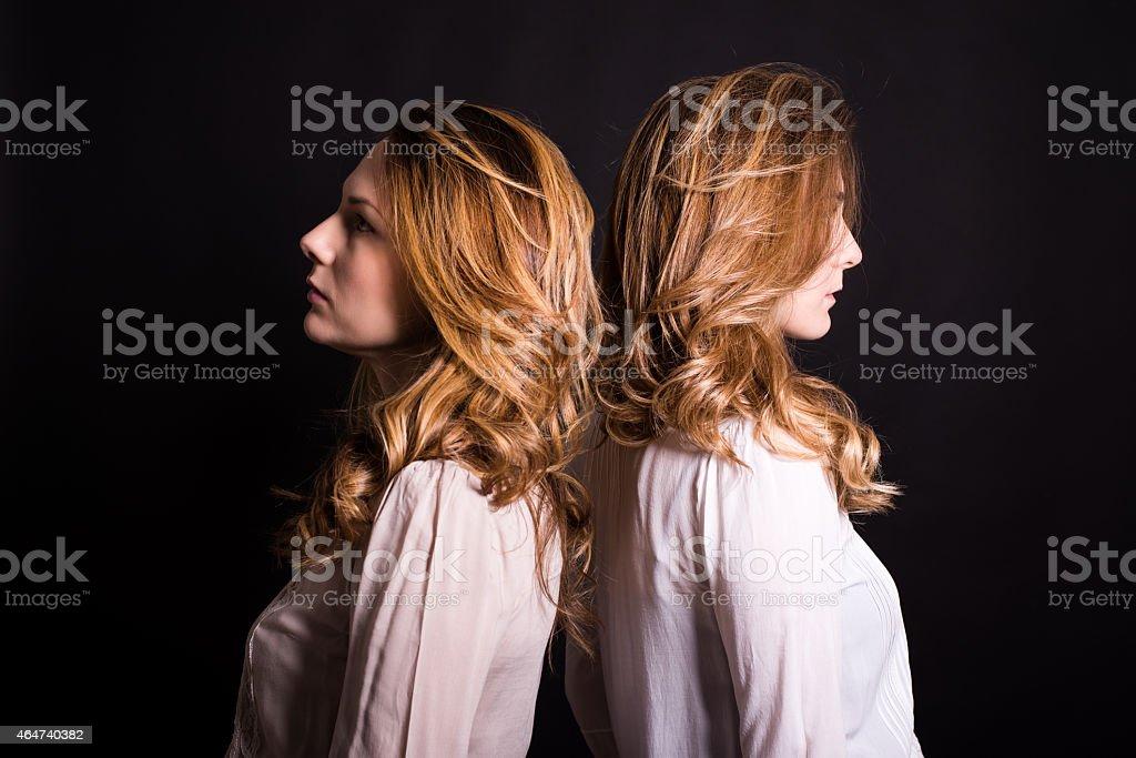 Profile of  two beautiful  young women stock photo