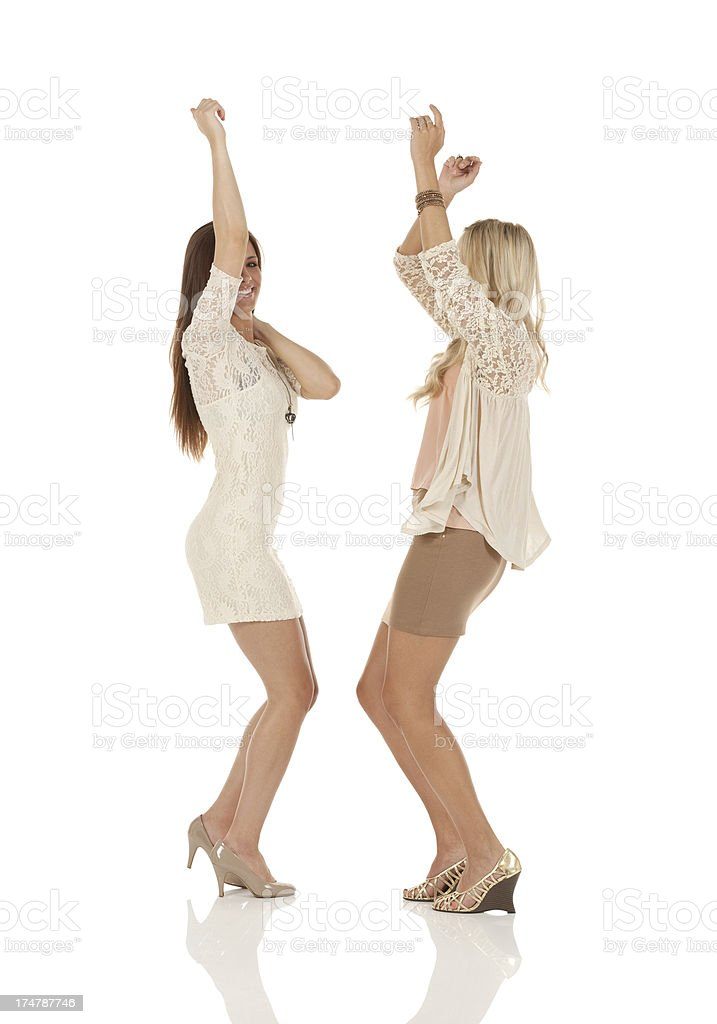 Profile of two female friends dancing royalty-free stock photo