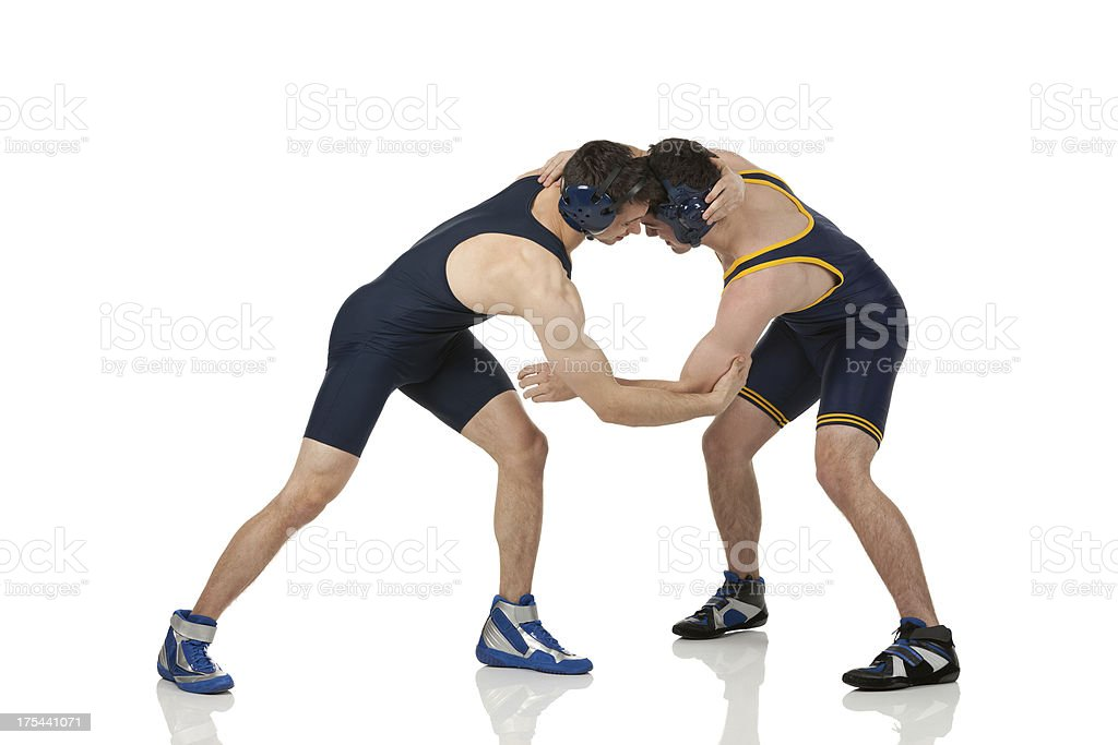 Profile of two men wrestling stock photo