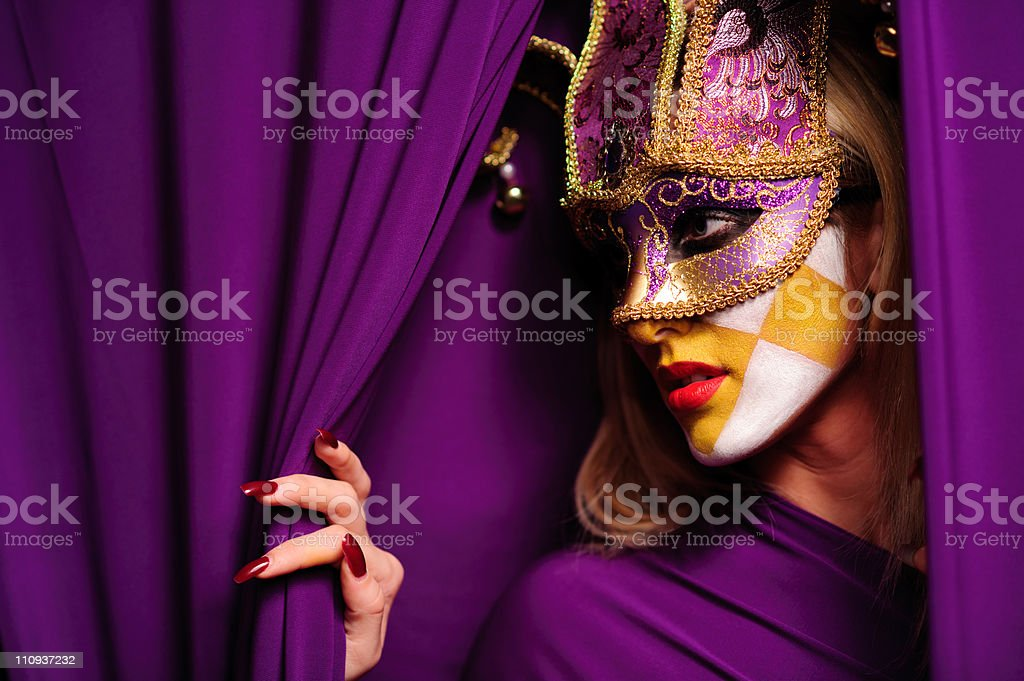 profile of woman in mask stock photo
