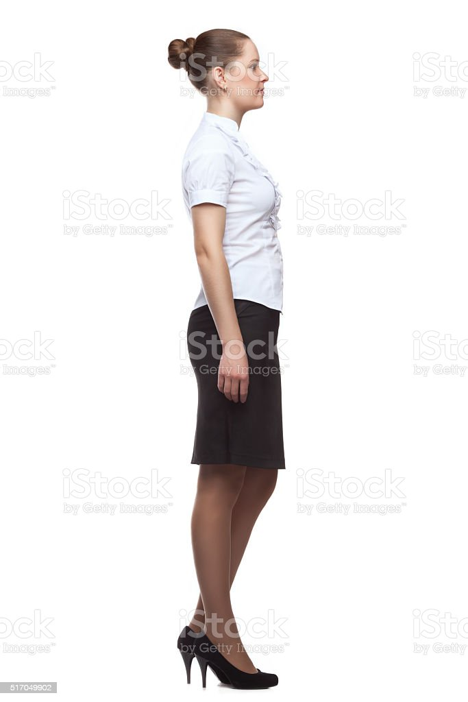 Profile of  young woman in full growth on white background stock photo