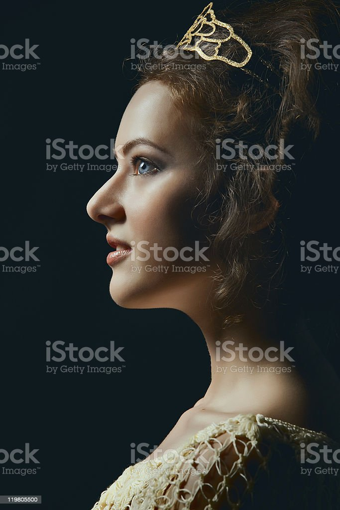 Profile of young woman on black background royalty-free stock photo
