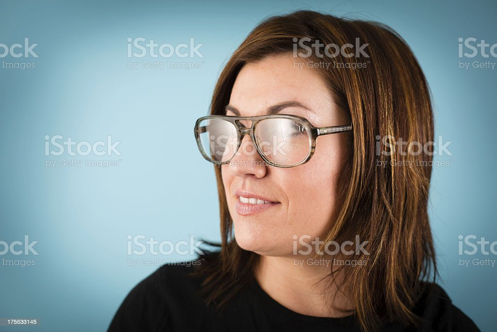 Profile of Young Woman Wearing Vintage Eyeglasses royalty-free stock photo
