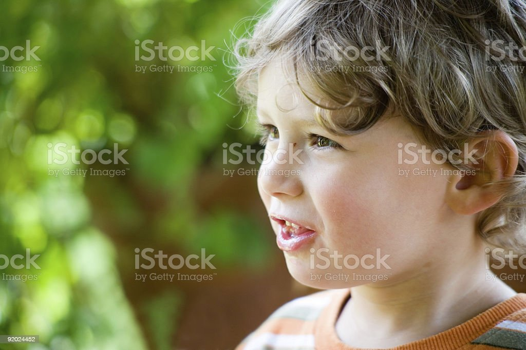 A profile portrait of a boy speaking royalty-free stock photo