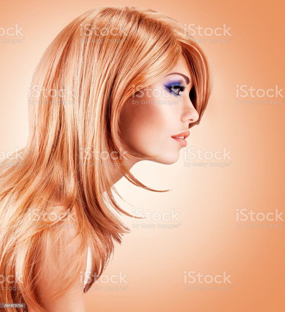 Profile portrait  of  beautiful pretty woman with long red hairs stock photo