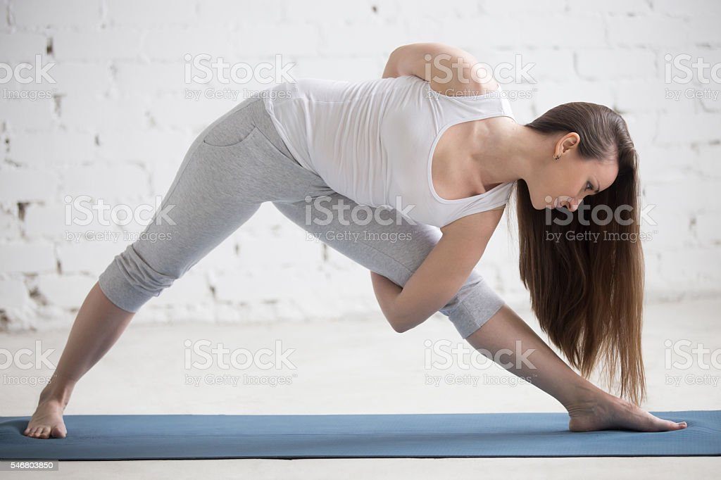 Profile portrait of beautiful woman working out stock photo