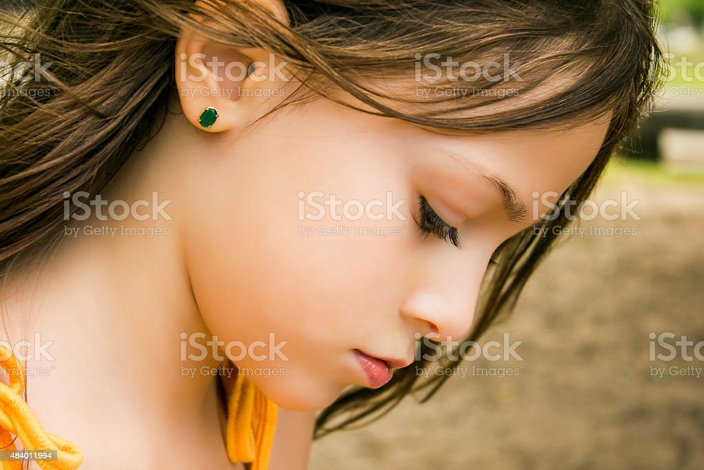 Profile Portrait of Beautiful Young Girl stock photo