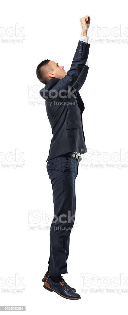 Profile portrait of hanging businessman grabbed something, isolated on white stock photo
