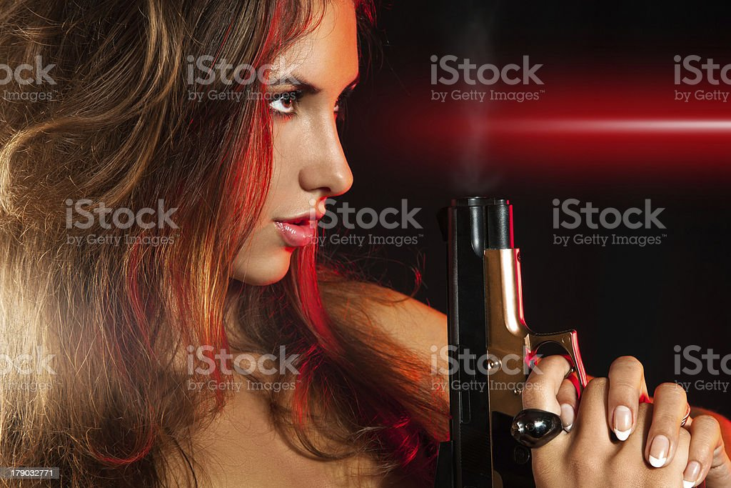 Profile portrait of nice female with gun royalty-free stock photo