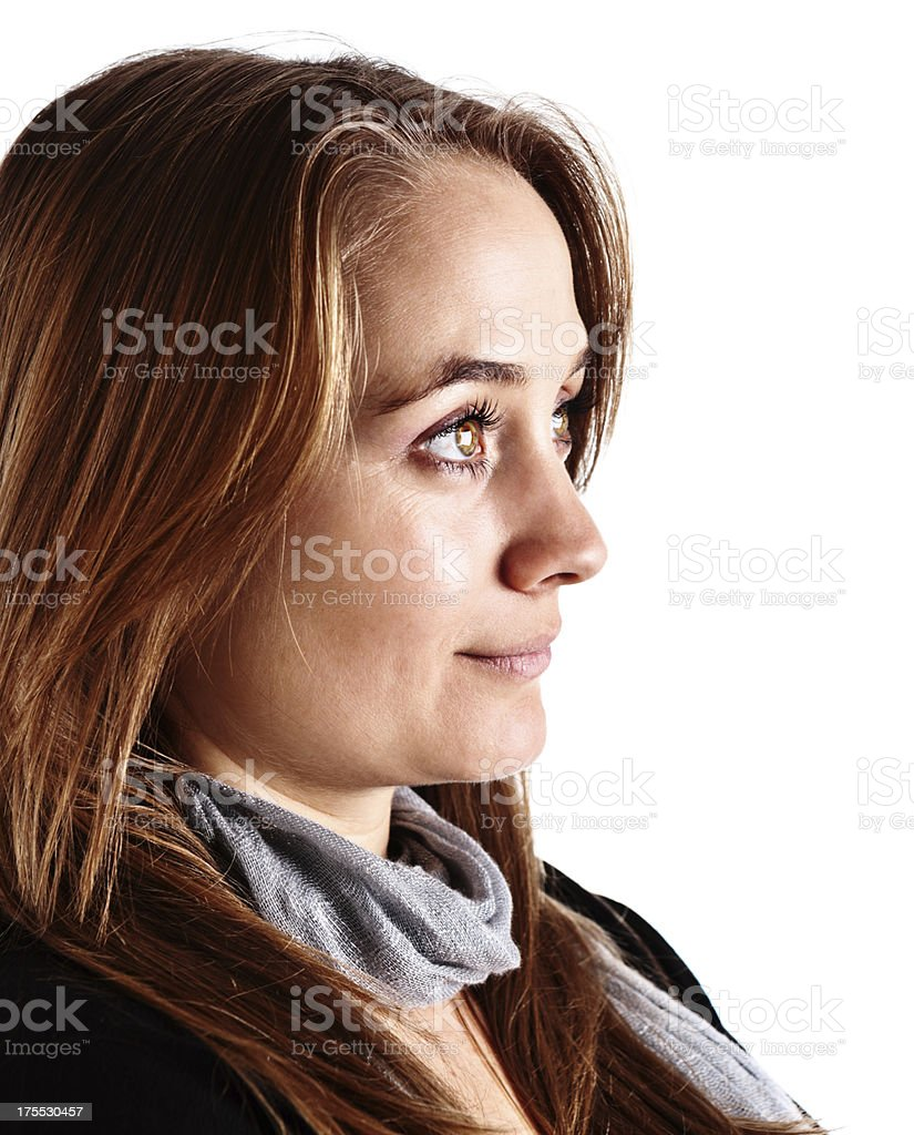 Profile portrait of serenely smiling young blonde beauty stock photo