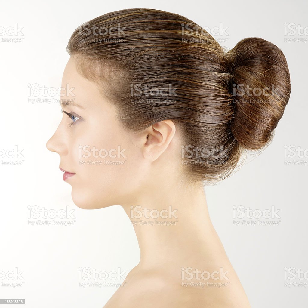 Profile portrait young adult woman with clean fresh skin stock photo