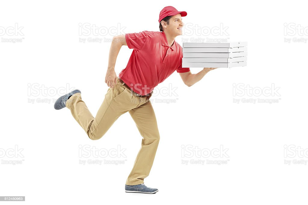Profile shot of a pizza delivery guy running stock photo