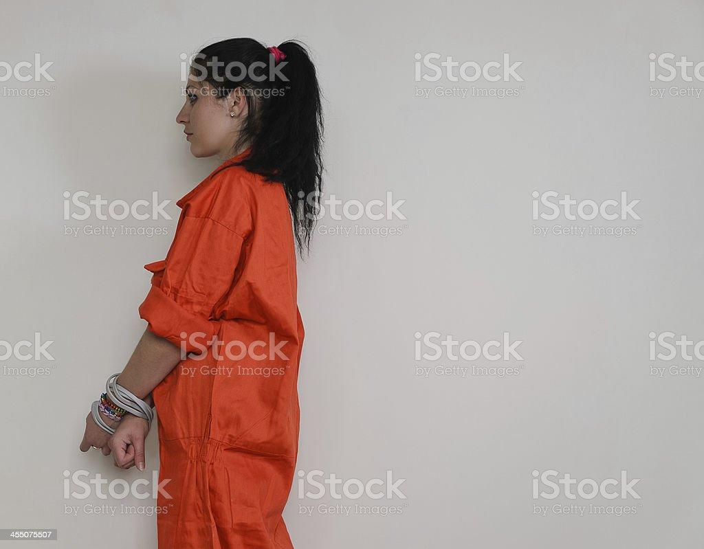 Profile shot of a woman in orange stock photo