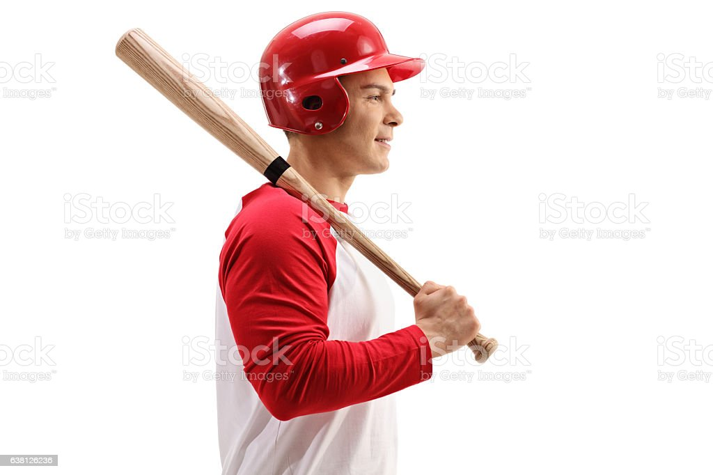 Profile shot of baseball player with helmet and bat stock photo