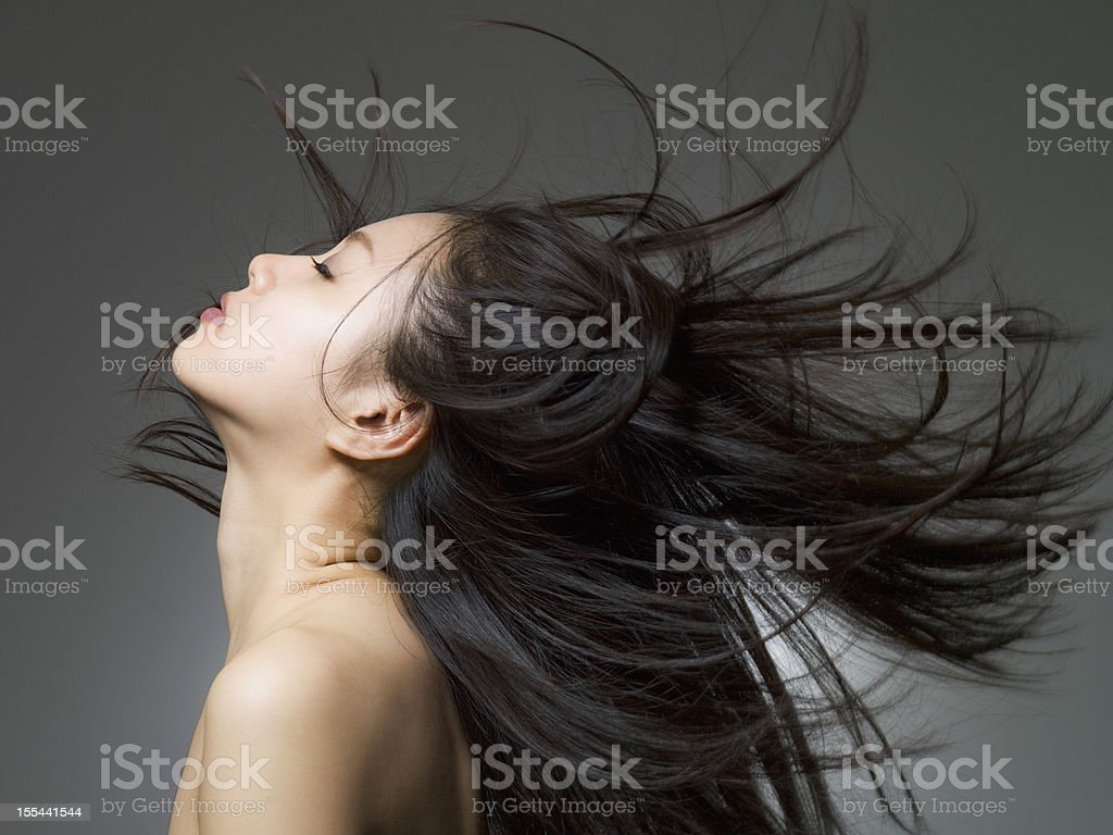 Profile shot of the woman who looks up stock photo