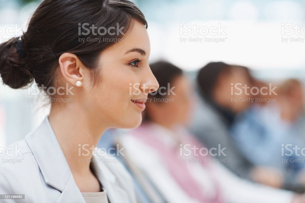 Profile view of a successful young businesswoman at  conference royalty-free stock photo