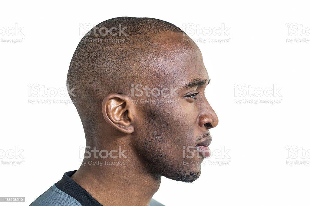 Profile view of confident sportsman stock photo