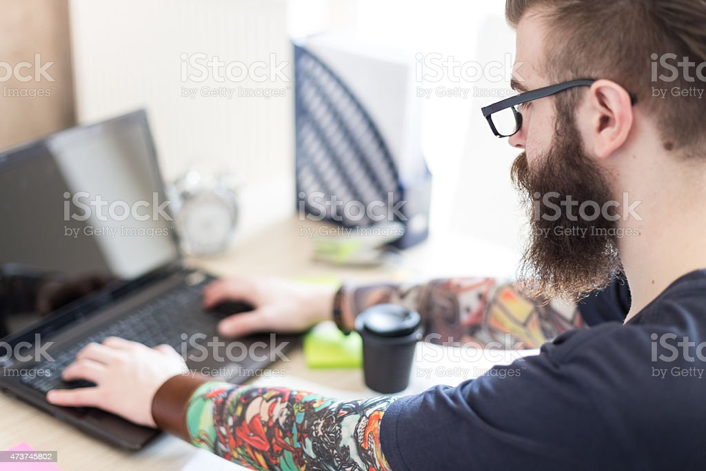 Profile view of graphic designer working stock photo