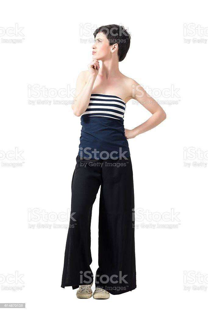 Profile view of young pretty woman thinking and looking up stock photo