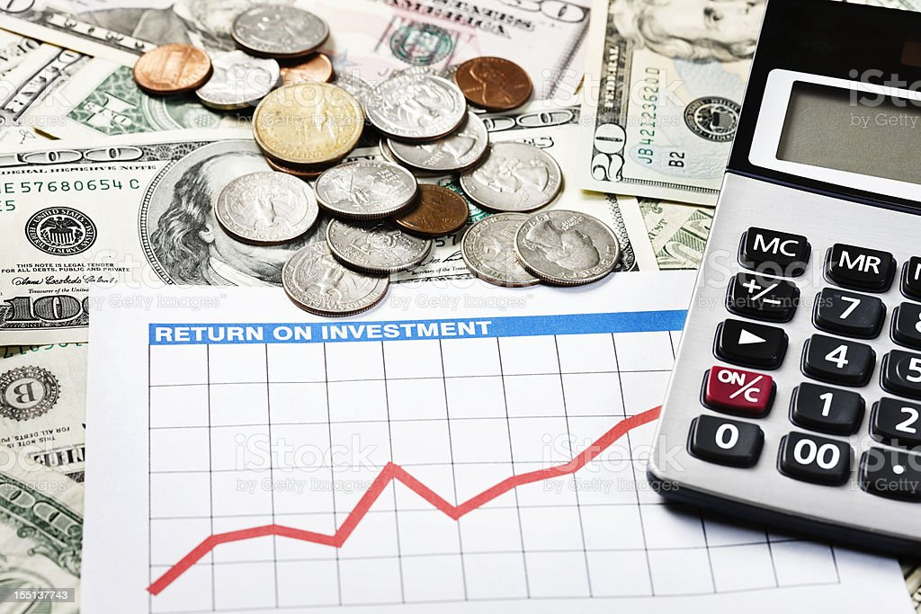 Profit center: rising graph and calculator on US currency royalty-free stock photo
