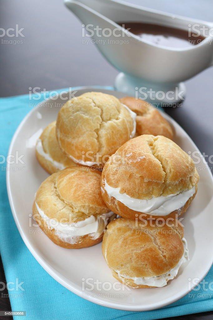 Profiteroles with cream caramel sauce stock photo