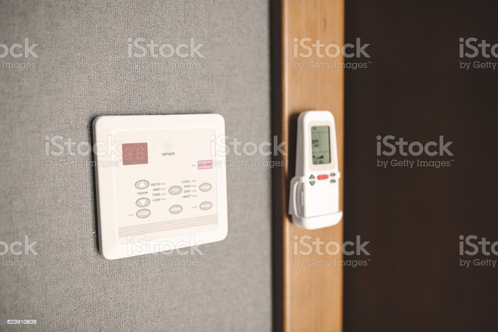Programmable thermostat in room stock photo