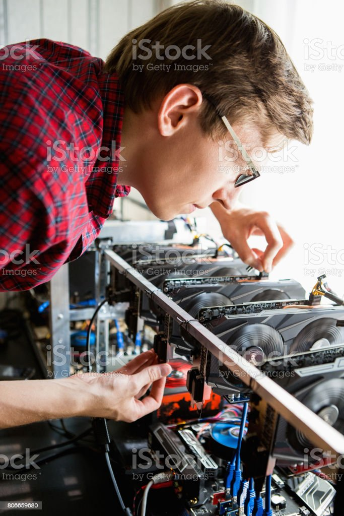 Programmer configures the computer for mining stock photo