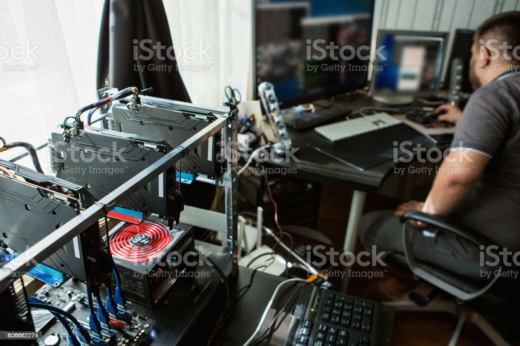 Programmer configures the computer stock photo