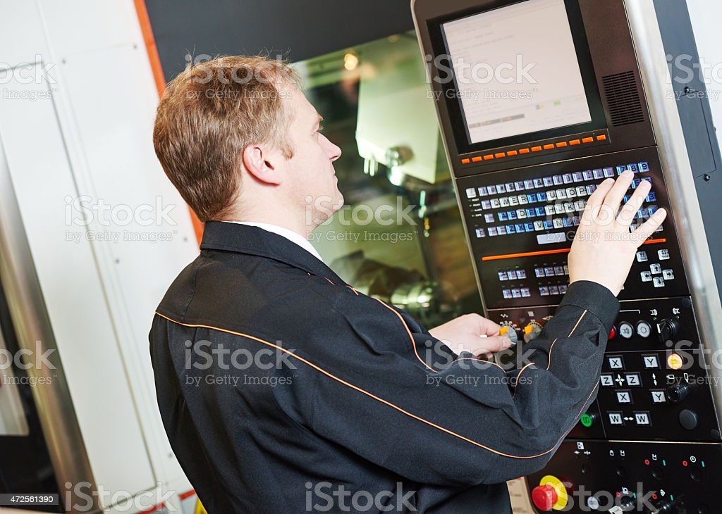 programmer engineer with metal working machine stock photo