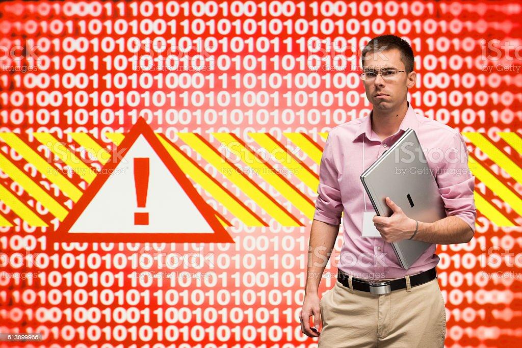 Programmer holding laptop stock photo