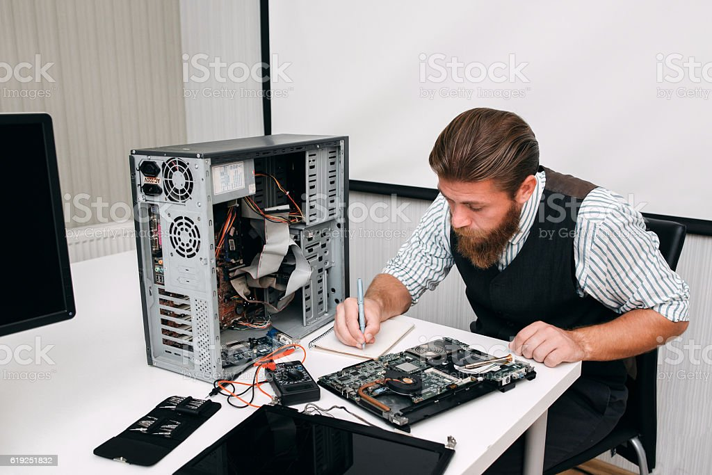 Programmer inventorying of electronic equipment stock photo