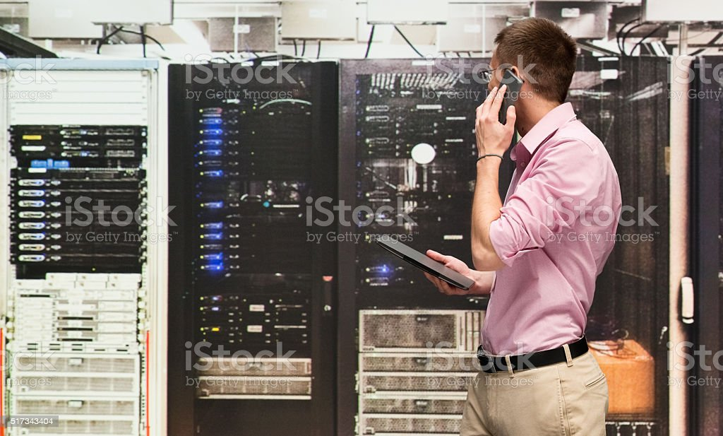 Programmer talking on phone stock photo