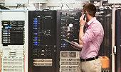 Programmer talking on phone