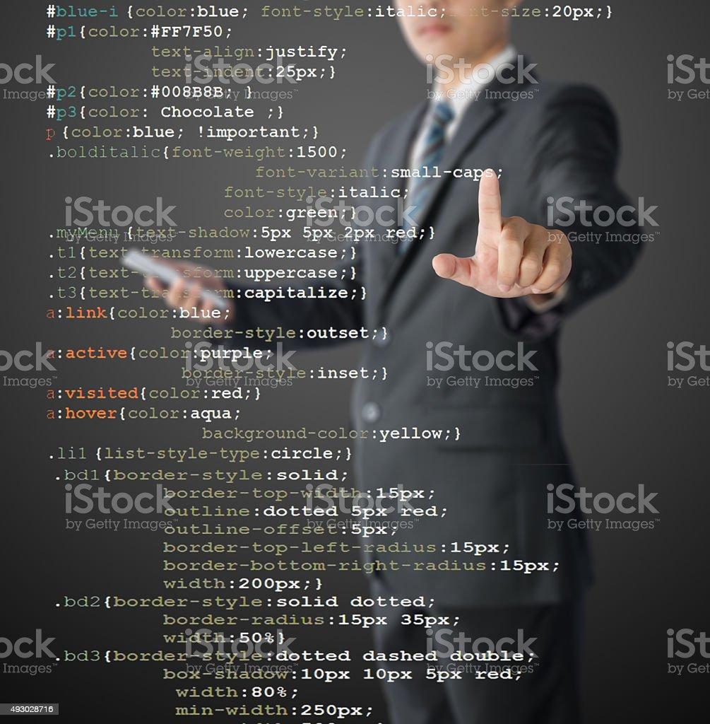 programmer writing CSS code stock photo