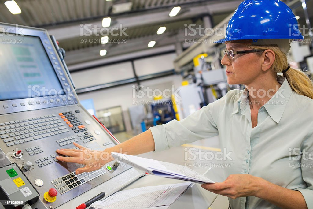 Programming A CNC Machine stock photo