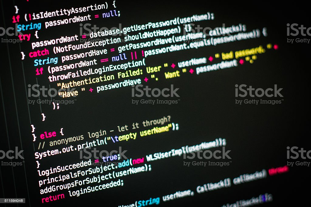 Programming code on the monitor stock photo