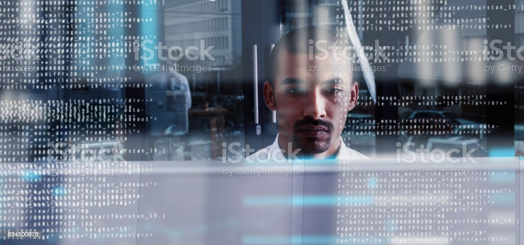 Programming like the pro that he is stock photo