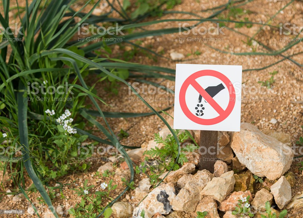 prohibition sign on bottom - dont picking up the plants stock photo