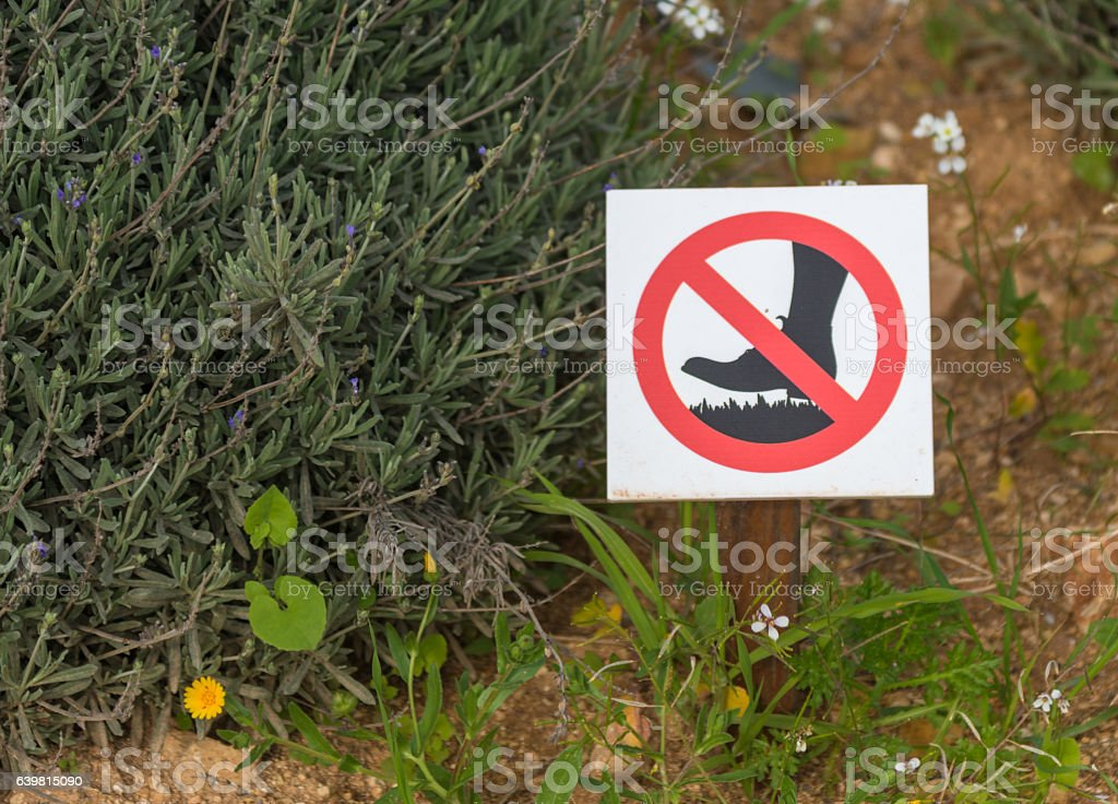 prohibition sign on bottom - dont step on the plants stock photo