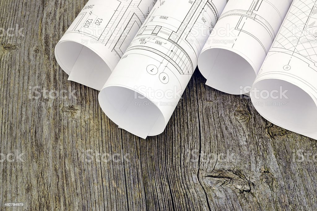 Project drawings on the background of wooden boards royalty-free stock photo